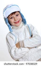 Portrait of little kid in winter wear against white background