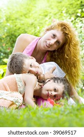 Portrait of little kids with mama  having good time in summer environment