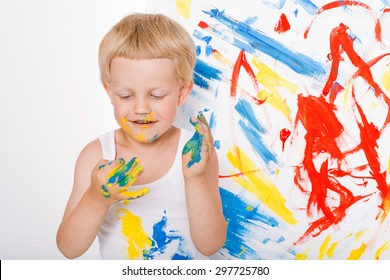 Portrait of a little messy kid painter. School. Preschool. Education. Creativity. Studio portrait over white background