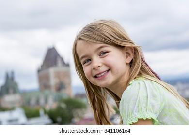 A Portrait of little pretty girl outside