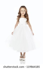 Portrait of a little princess girl wearing wedding dress isolated on white background