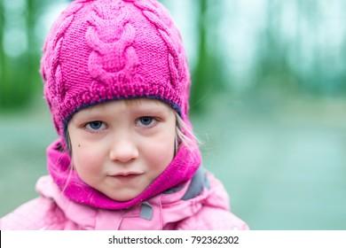 Portrait of little sad girl outdoor