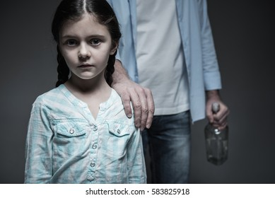Portrait of little sad girl posing on camera