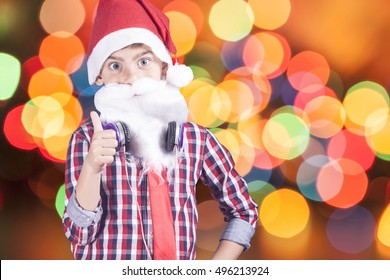 Portrait of a little Santa Claus on a defocused bokeh Christmas lights background. Selective focus image