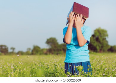 Portrait of little schoolboy with book - outdoor