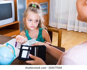Portrait of little schoolgirl asking money for a day
