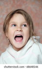 portrait of a little screaming girl
