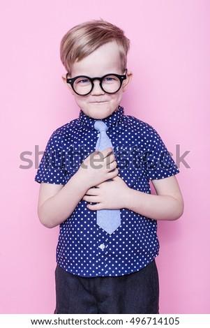 25e2338954e Portrait of a little smiling boy in a funny glasses and tie. School.  Preschool