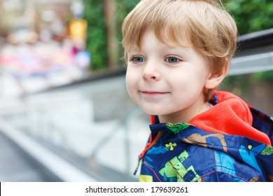 Portrait of little toddler boy three years old in shopping mall