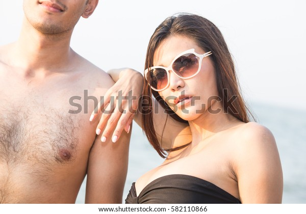 portrait of living young couple at the beach.