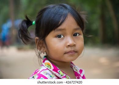 Portrait of a local girl at Angkor Wat. Angkor Wat, Cambodia - 31/DEC/2013