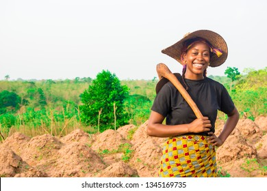 portrait of a local young black female farmer smiling