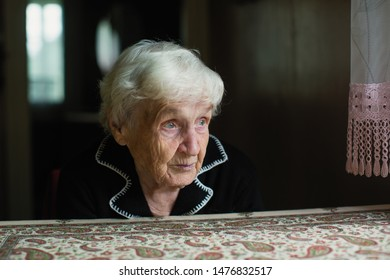Portrait of a lonely sad old woman in his home.