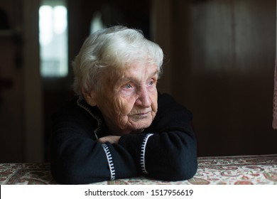 Portrait of a lonely sceptical old woman in his home.