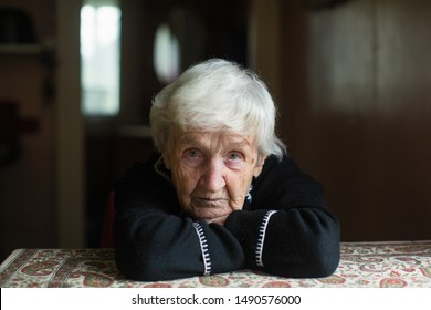 Portrait of a lonely with worried look elderly woman.