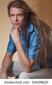 Portrait of the long haired blond male model