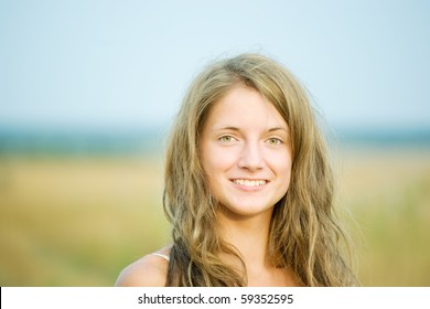 portrait of  long-haired girl  outdoor in summer
