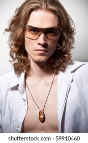 Portrait of long-haired handsome man in sunglasses