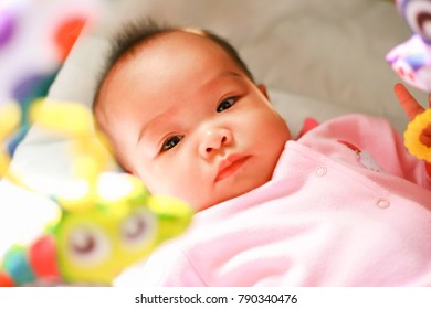 Portrait of a looking baby on the bedroom