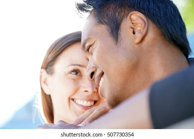 Portrait of in love couple relaxing in park