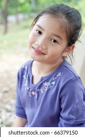 Portrait of lovely asian girl in violet suit, Thailand.