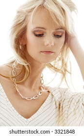 portrait of lovely blond with golden necklace