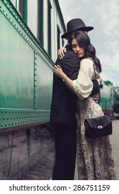 portrait of lovely couple on railway station