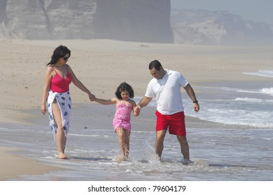 Portrait of a lovely romantic family on the beach
