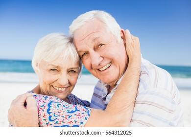 Portrait of lovely senior couple on the beach