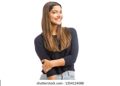 Portrait of lovely woman with smile on her face standing in studio