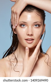 portrait of lovely woman with wet hair touching her face, fresh and beautiful female after bath, pretty girl touching face with naked shoulders