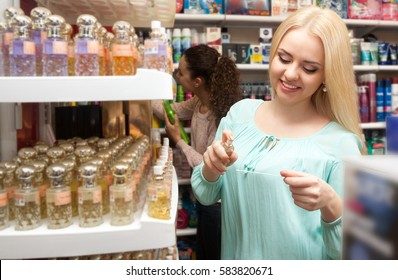 Portrait of lovely young blondie shopping in beauty store