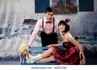 Portrait of lovely young couple looking to you
