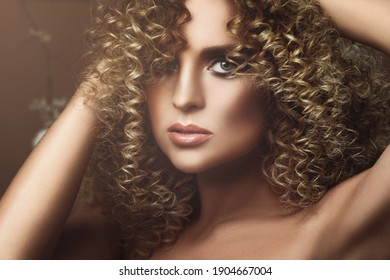 Portrait of lovely young woman with Afro hairstyle and beautiful make-up