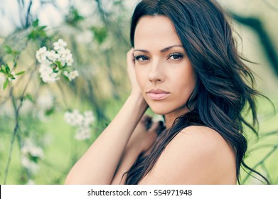Portrait of a lovely young woman with perfect skin
