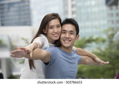 Portrait of a loving Asian couple enjoying themselves on a date.