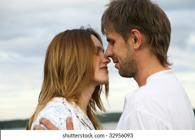 Portrait of loving couple on a sky background