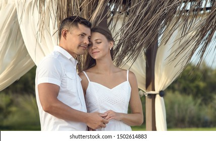 portrait loving couple in white dress,  honeymoon or  holiday - vacation concept