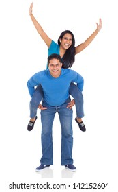 portrait of loving indian couple having fun with piggyback ride isolated over white background