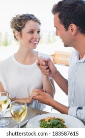 Portrait of a loving young couple with wine glasses looking at each other