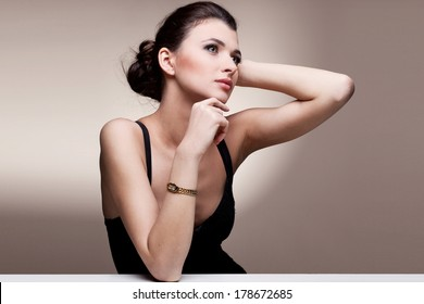 Portrait of luxury woman in exclusive jewelry watch on natural background