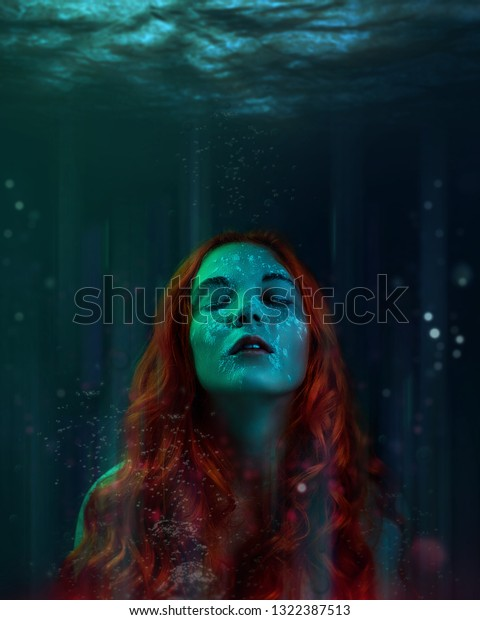 A portrait magical fairy mermaid girl with very long red hair in under water, sea queen, halloween image, water nymph or a drowned woman. art