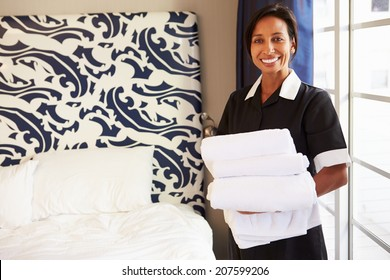 Portrait Of Maid Tidying Hotel Room