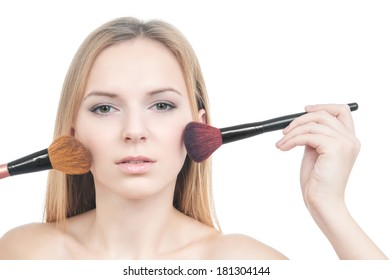 Portrait of makeup girl with blusher brushes isolated on white