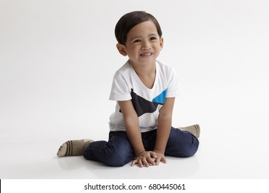 portrait of malay boy about 3 to 6 years old sitting