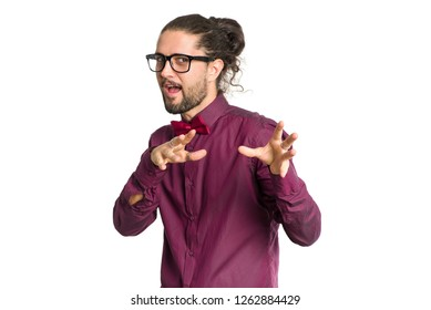 Portrait of a male artist with glasses who shows a gesture that there will be magic trick, isolated on a white background.
