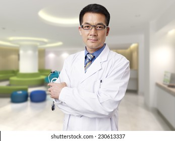 portrait of a male asian doctor in hospital lobby.