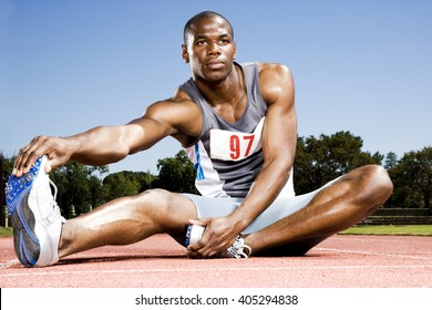 Portrait of a male athlete warming up and stretching