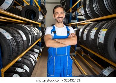Portrait of  male auto mechanic in tire store