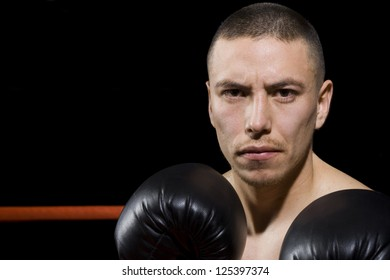 Portrait of a male boxer ready to punch